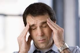Отчего болит голова